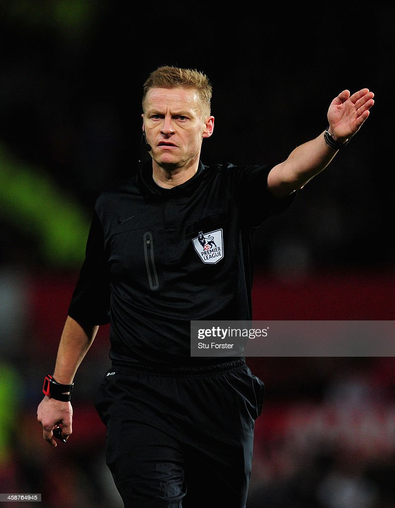 Referee Michael Jones gestures during the Barclays Premier League match between Manchester United and West Ham United at Old Trafford on December 21, 2013 in Manchester, England.