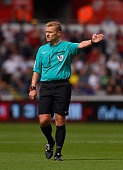 Referee Michael Jones in action during the Barclays Premier League match between Swansea City and Newcastle United at the Liberty stadium on August...