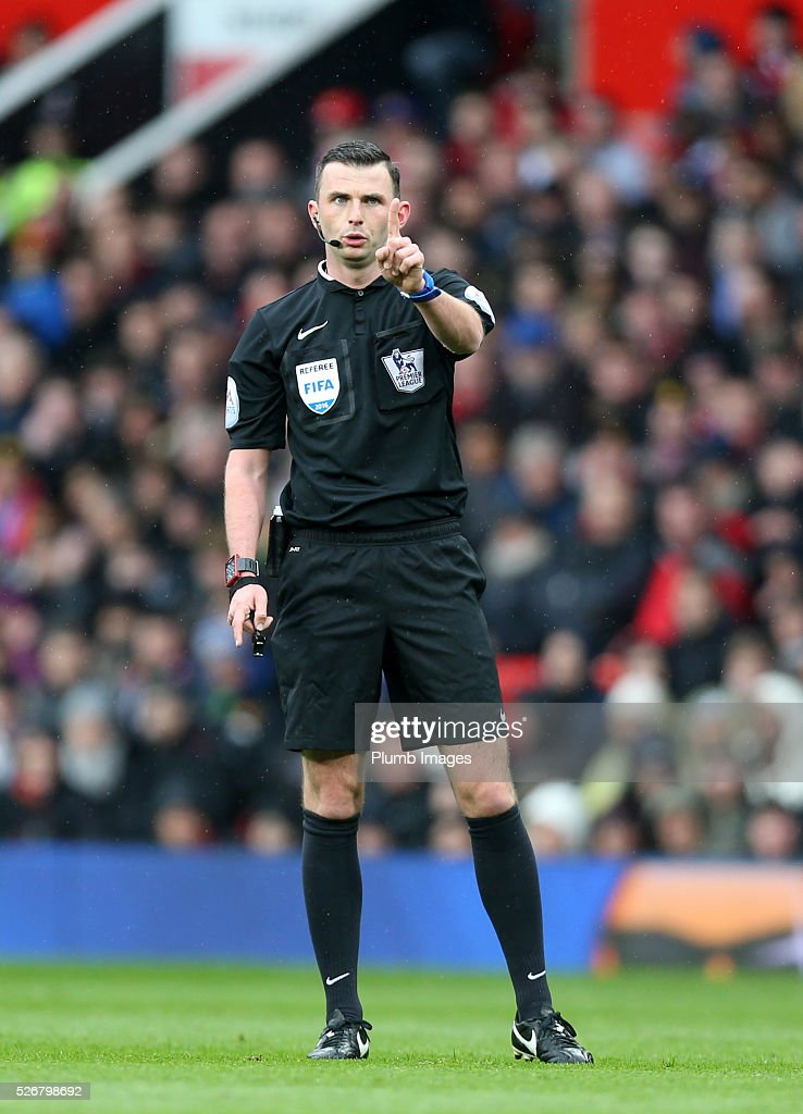 Referee Michael Oliver during the Premier League match between Manchester United and Leicester City at Old Trafford on May 01, 2016 in Manchester, United Kingdom.