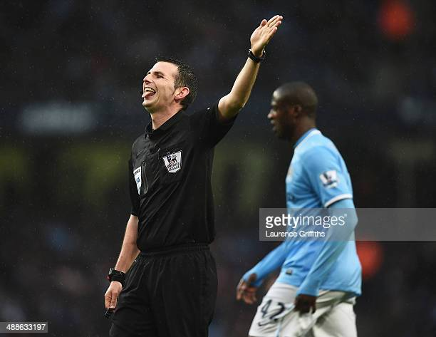 Referee Michael Oliver gestures during the Barclays Premier League match between Manchester City and Aston Villa at Etihad Stadium on May 7 2014 in...