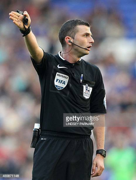 Referee Michael Oliver gestures during the English Premier League football match between Everton and Crystal Palace at Goodison Park in Liverpool on...