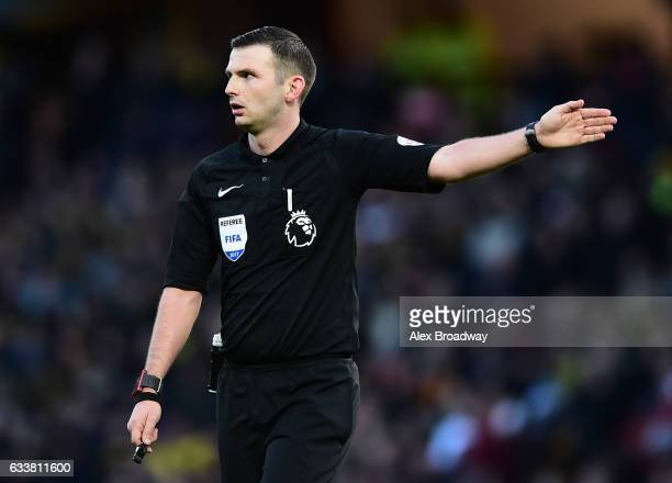 Referee Michael Oliver gestures during the Premier League match between Watford and Burnley at Vicarage Road on February 4 2017 in Watford England