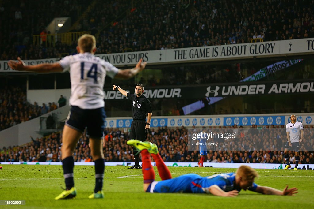 Referee Michael Oliver gestures to Lewis Holtby of Spurs during the Barclays Premier League match between Tottenham Hotspur and Hull City at White Hart Lane on October 27, 2013 in London, England.