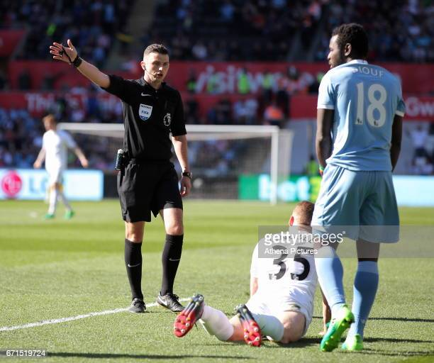Referee Michael Oliver gives a foul kick to Swansea after Stephen Kingsley of Swansea City was fouled during the Premier League match between Swansea...