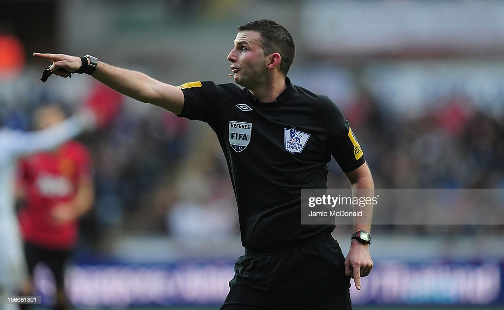 Referee Michael Oliver in action during the Barclays Premier League match between Swansea City and Manchester United at the Liberty Stadium on December 23, 2012 in Swansea, Wales.