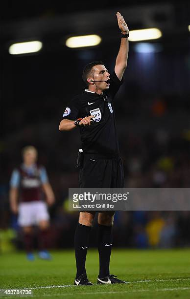 Referee Michael Oliver in action during the Barclays Premier League match between Burnley and Chelsea at Turf Moor on August 18 2014 in Burnley...