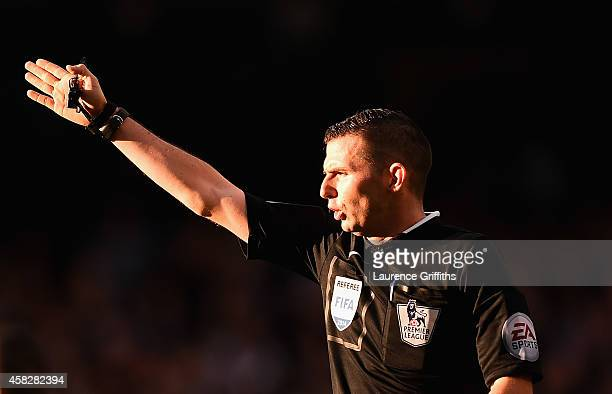 Referee Michael Oliver in action during the Barclays Premier League match between Manchester City and Manchester United at Etihad Stadium on November...