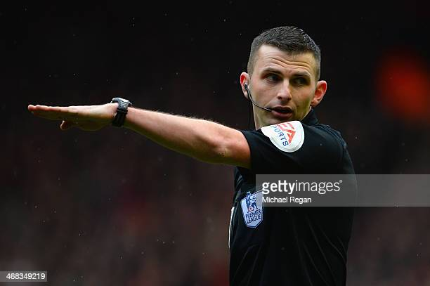 Referee Michael Oliver in action during the Barclays Premier League match between Liverpool and Arsenal at Anfield on February 8 2014 in Liverpool...