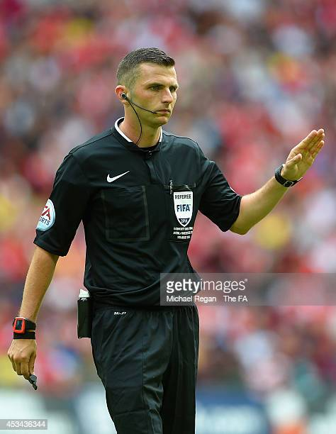 Referee Michael Oliver in action during the FA Community Shield match between Manchester City and Arsenal at Wembley Stadium on August 10 2014 in...