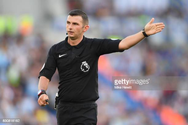 Referee Michael Oliver in action during the Premier League match between Brighton and Hove Albion and Manchester City at Amex Stadium on August 12...