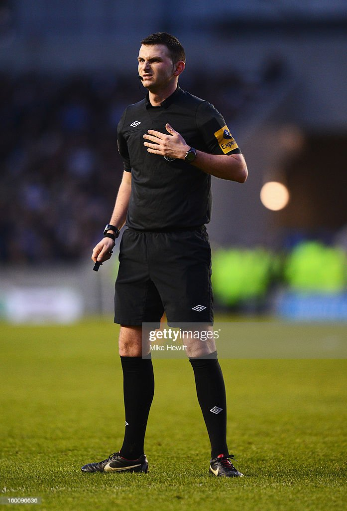 Referee Michael Oliver looks on during the FA Cup with Budweiser Fourth Round match between Brighton & Hove Albion and Arsenal at Amex Stadium on January 26, 2013 in Brighton, England.