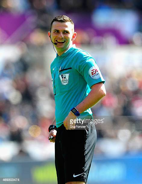 Referee Michael Oliver raises a smile during the Barclays Premier League match between Swansea City and Everton at Liberty Stadium on April 11 2015...