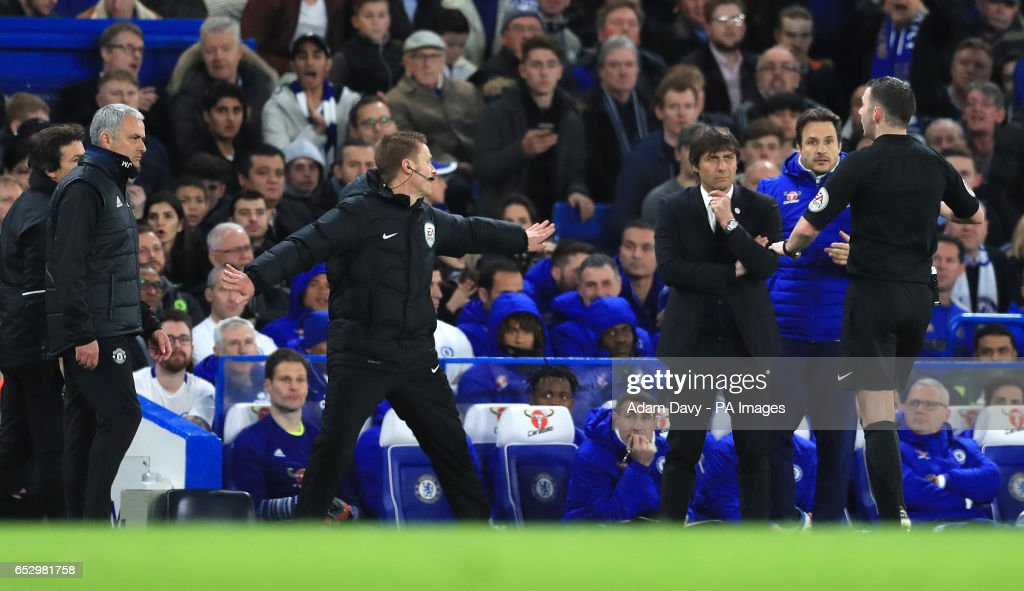 Referee Michael Oliver runs over to speak to Manchester United manager Jose Mourinho and Chelsea manager Antonio Conte during the Emirates FA Cup, Quarter Final match at Stamford Bridge, London.