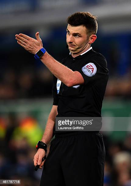 Referee Michael Oliver signals during the Barclays Premier League match between Everton and West Bromwich Albion at Goodison Park on January 19 2015...
