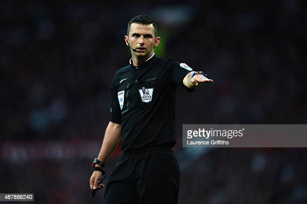 Referee Michael Oliver signals during the Barclays Premier League match between Manchester United and Liverpool at Old Trafford on September 12 2015...