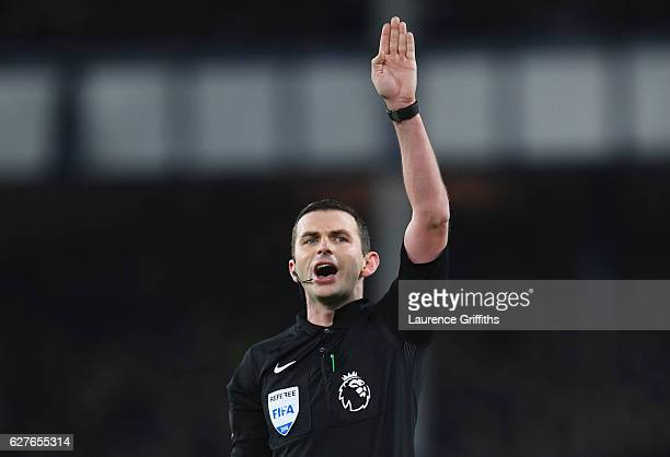 Referee Michael Oliver signals during the Premier League match between Everton and Manchester United at Goodison Park on December 4 2016 in Liverpool...