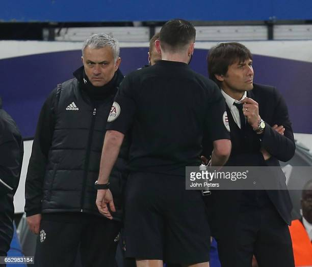 Referee Michael Oliver speaks to Manager Jose Mourinho of Manchester United and Manager Antonio Conte of Chelsea during the Emirates FA Cup...