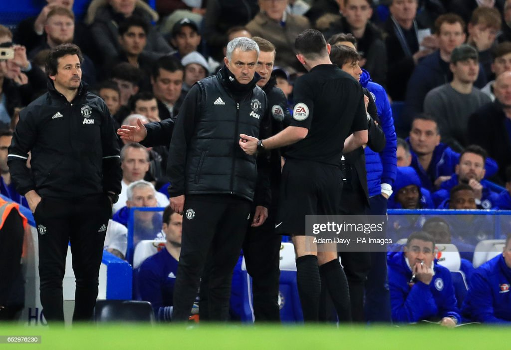 Referee Michael Oliver speaks to Manchester United manager Jose Mourinho and Chelsea manager Antonio Conte during the Emirates FA Cup, Quarter Final match at Stamford Bridge, London.
