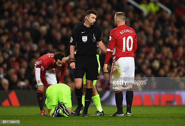 Referee Michael Oliver speaks to Wayne Rooney of Manchester United during the Premier League match between Manchester United and Liverpool at Old...