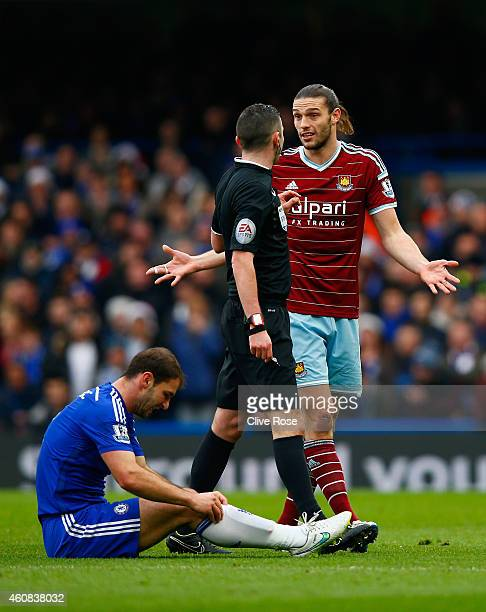 Referee Michael Oliver speaks with Andy Carroll of West Ham after a foul on Branislav Ivanovic of Chelsea during the Barclays Premier League match...