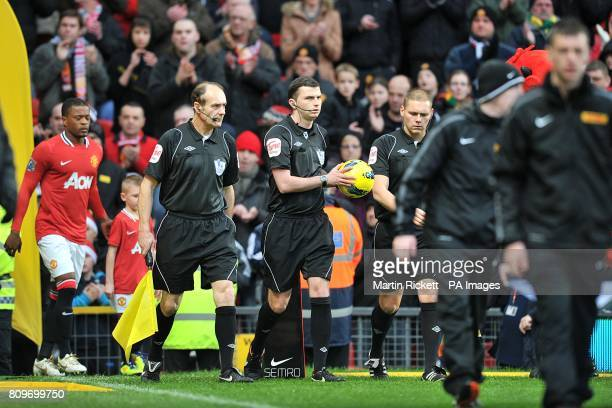 Referee Michael Oliver takes the matchball from it's plinth before the game