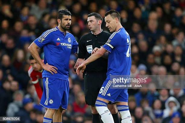 Referee Michael Oliver talks to Diego Costa and to John Terry of Chelsea during the Barclays Premier League match between Chelsea and Manchester...