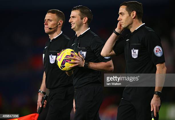 Referee Michael Oliver walks onto the pitch with the match ball ahead of the Barclays Premier League match between Crystal Palace and Aston Villa at...