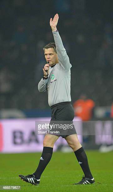 Referee Michael Weiner gestures during the Bundesliga match between Hertha BSC and 1 FC Nuernberg at Olympiastadion on February 2 2014 in Berlin...