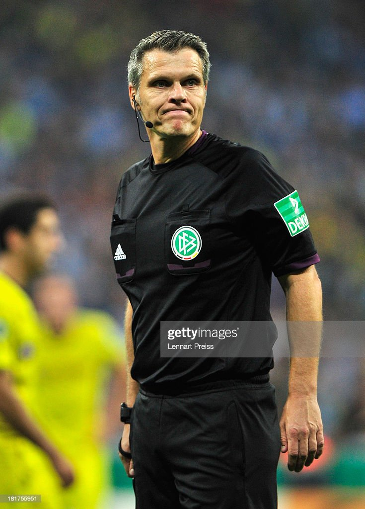 Referee Michael Weiner looks on during the DFB Cup match between TSV 1860 Muenchen and Borussia Dortmund at Allianz Arena on September 24, 2013 in Munich, Germany.