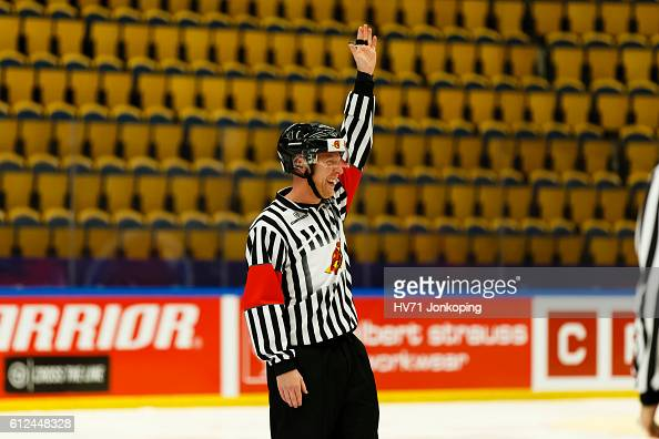 Referee Mikael Holm gestures during the Champions Hockey League Round of 32 match between HV71 Jonkoping and Lukko Rauma at Kinnarps Arena on October...