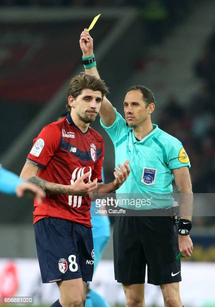 Referee Mikael Lesage gives a yellow card to Xeka of Lille during the French Ligue 1 match between Lille OSC and Olympique de Marseille at Stade...
