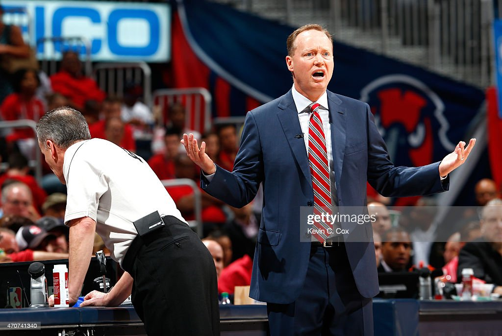 Referee Mike Callahan #24 checks the scorers table as Mike Budenholzer of the Atlanta Hawks reacts to a call during Game Two of the Eastern Conference Quarterfinals of the NBA Playoffs against the Brooklyn Nets at Philips Arena on April 22, 2015 in Atlanta, Georgia.