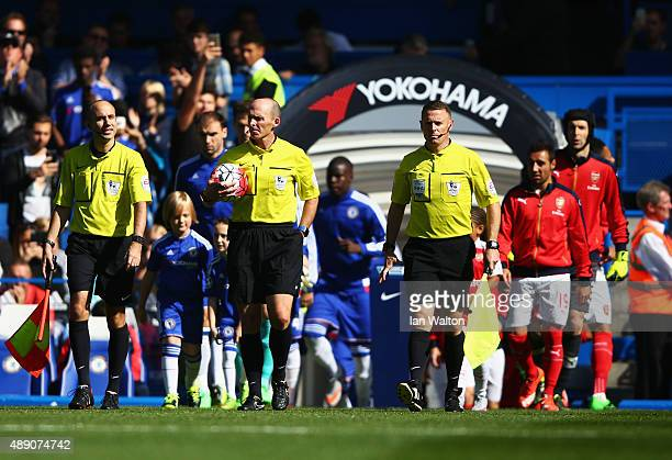 Referee Mike Dean and players walk into the pitch prior to the Barclays Premier League match between Chelsea and Arsenal at Stamford Bridge on...