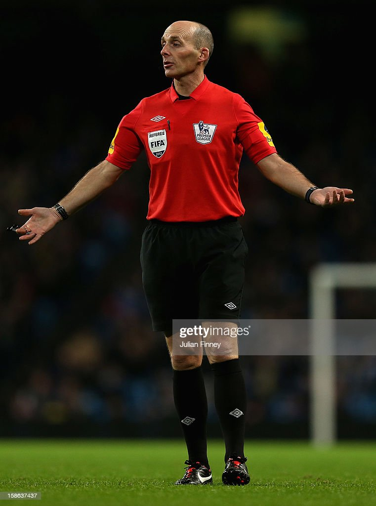 Referee, Mike Dean during the Barclays Premier League match between Manchester City and Reading at Etihad Stadium on December 22, 2012 in Manchester, England.