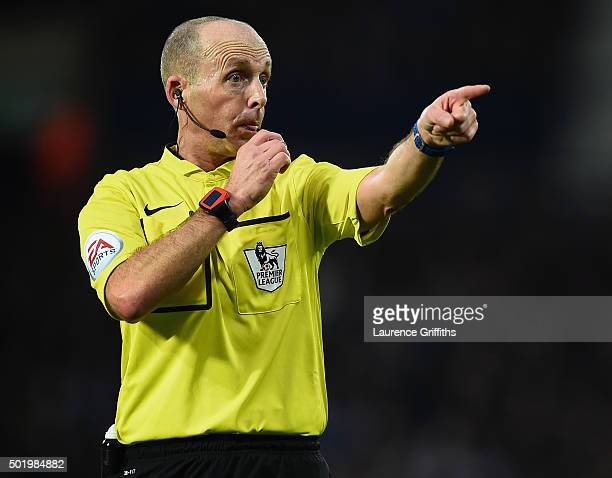 Referee Mike Dean gestures during the Barclays Premier League match between West Bromwich Albion and AFC Bournemouth at The Hawthorns on December 19...