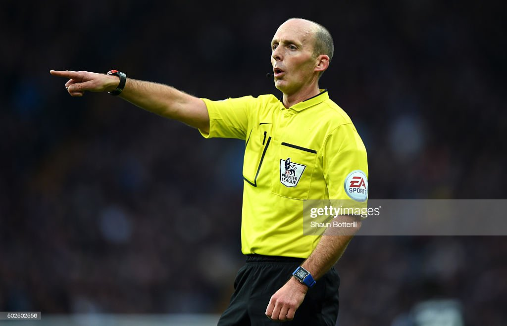 Referee, <a gi-track='captionPersonalityLinkClicked' href=/galleries/search?phrase=Mike+Dean+-+Referee&family=editorial&specificpeople=4517613 ng-click='$event.stopPropagation()'>Mike Dean</a> gestures during the Barclays Premier League match between Aston Villa and West Ham United at Villa Park on December 26, 2015 in Birmingham, England.