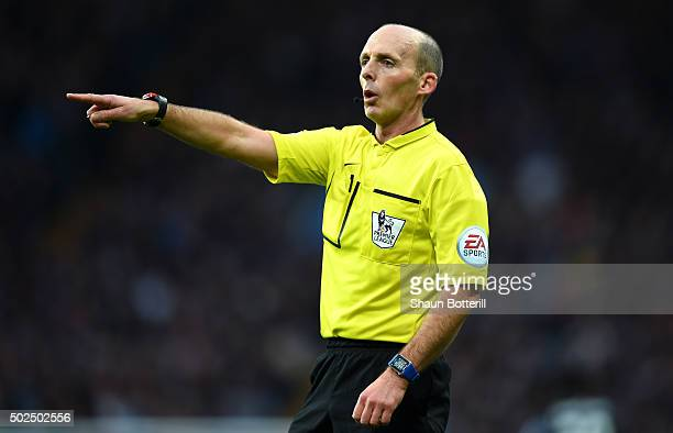 Referee Mike Dean gestures during the Barclays Premier League match between Aston Villa and West Ham United at Villa Park on December 26 2015 in...