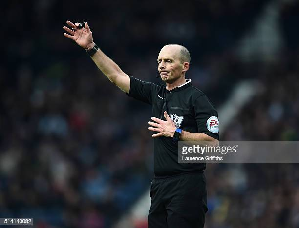 Referee Mike Dean gestures during the Barclays Premier League match between West Bromwich Albion and Manchester United at The Hawthorns on March 6...