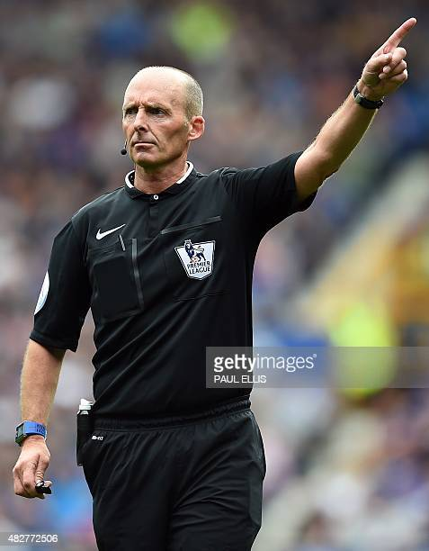Referee Mike Dean gestures during the Duncan Ferguson Testimonal preseason friendly football match between Everton and Villarreal at Goodison Park in...