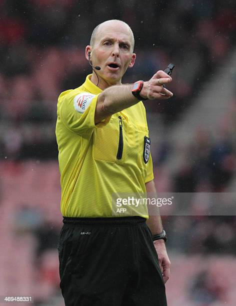 Referee Mike Dean gestures during the English FA Cup fifth round football match between Sunderland and Southampton at The Stadium of Light in...