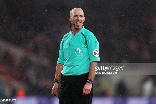 Referee Mike Dean gestures during the Premier League match between Middlesbrough and Everton at Riverside Stadium on February 11 2017 in...