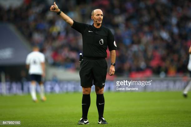Referee Mike Dean gestures during the Premier League match between Tottenham Hotspur and Swansea City at Wembley Stadium on September 16 2017 in...