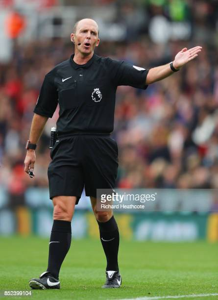 Referee Mike Dean gestures during the Premier League match between Stoke City and Chelsea at Bet365 Stadium on September 23 2017 in Stoke on Trent...