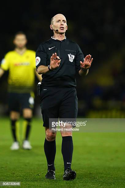 Referee mike dean in action during the Barclays Premier League match between Watford and Chelsea at Vicarage Road on February 3 2016 in Watford...
