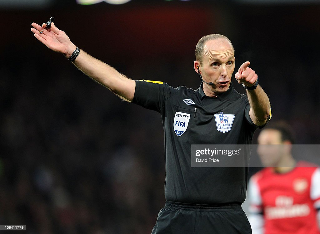 Referee Mike Dean reacts during the Barclays Premier League match between Arsenal and Manchester City at Emirates Stadium on January 13, 2013 in London, England.