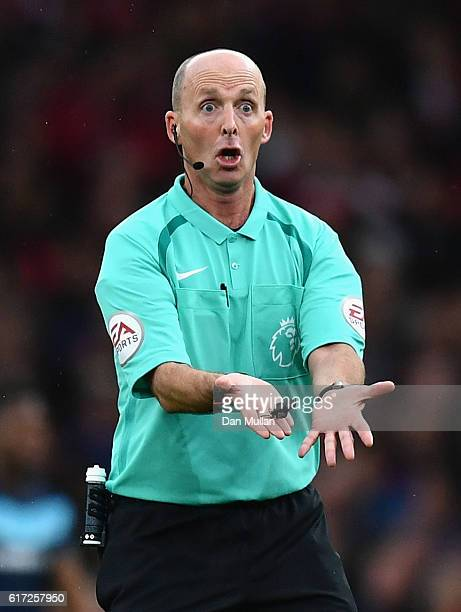 Referee Mike Dean reacts during the Premier League match between Arsenal and Middlesbrough at Emirates Stadium on October 22 2016 in London England