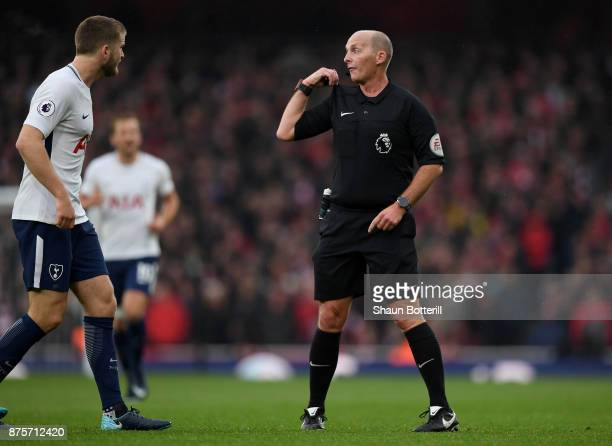 Referee Mike Dean reacts during the Premier League match between Arsenal and Tottenham Hotspur at Emirates Stadium on November 18 2017 in London...