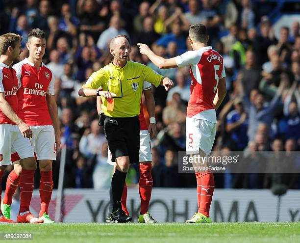 Referee Mike Dean sends off Arsenal defender Gabriel during the Barclays Premier League match between Chelsea and Arsenal on September 19 2015 in...