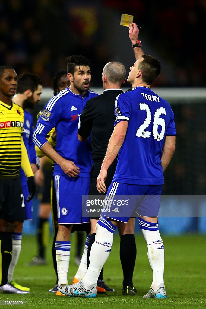 Referee <a gi-track='captionPersonalityLinkClicked' href=/galleries/search?phrase=Mike+Dean+-+%C3%81rbitro&family=editorial&specificpeople=4517613 ng-click='$event.stopPropagation()'>Mike Dean</a> shows the yellow card to Diego Costa of Chelsea during the Barclays Premier League match between Watford and Chelsea at Vicarage Road on February 3, 2016 in Watford, England.