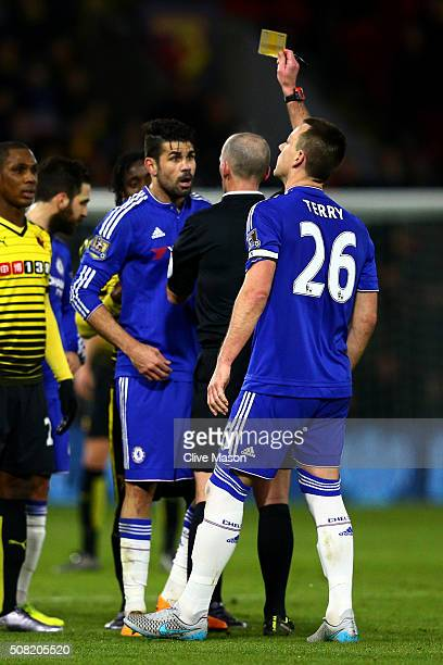 Referee Mike Dean shows the yellow card to Diego Costa of Chelsea during the Barclays Premier League match between Watford and Chelsea at Vicarage...